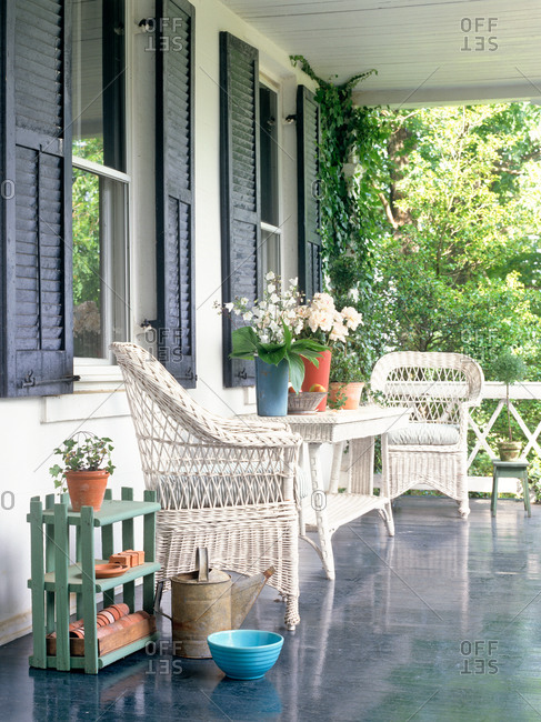 Summer porch with wicker furniture and flowers
