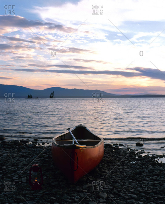 Canoe on Maine lake at sunset.