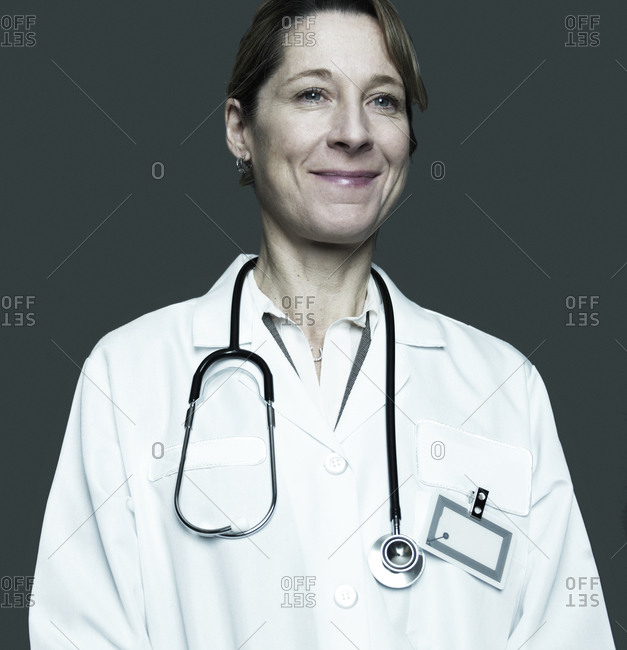 a healthcare practitioner wearing a white coat