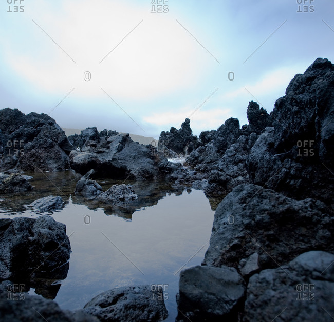 molten rock formation around a creek