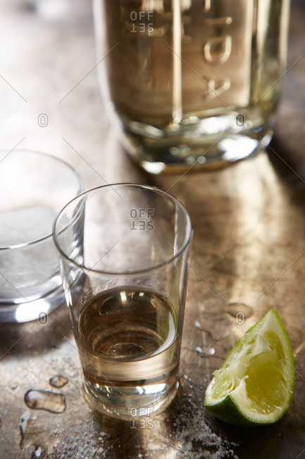 glass of tequila and a lime