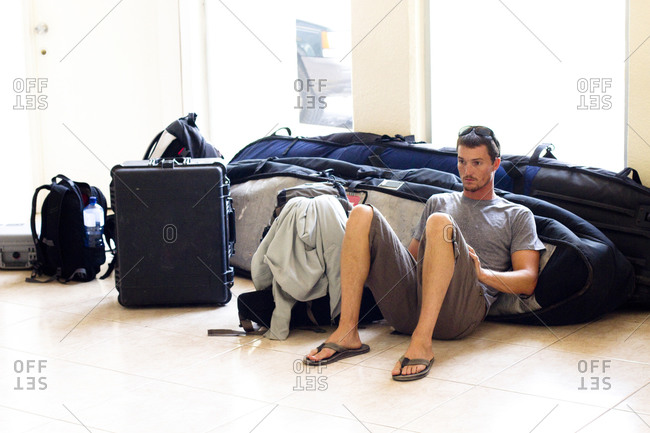 A man waits for his flight at the Manzanillo International Airport in Manzanillo, Mexico on May 7, 2011.  He was feeling sick and weary after surfing at Pascuales for several days in a row.