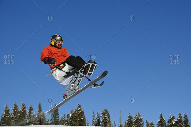 A handicap skier in air.