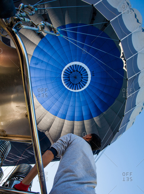Male passenger looking to hot air balloon