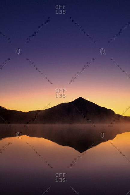 A reflection of mountain in a lake