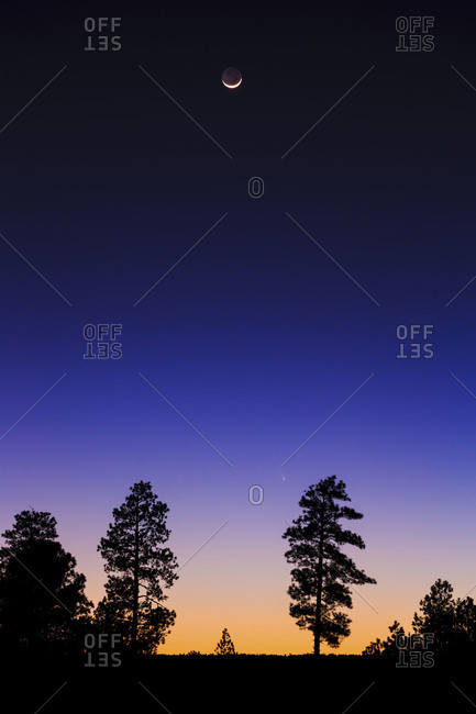 Sunset, moon, and comet