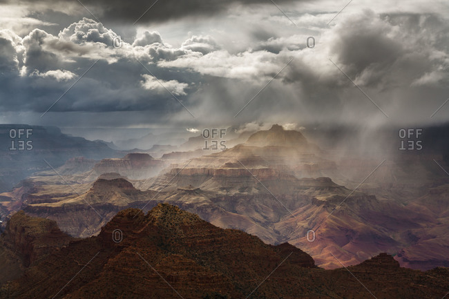 Geological rock formations in the clouds at the grand canyon
