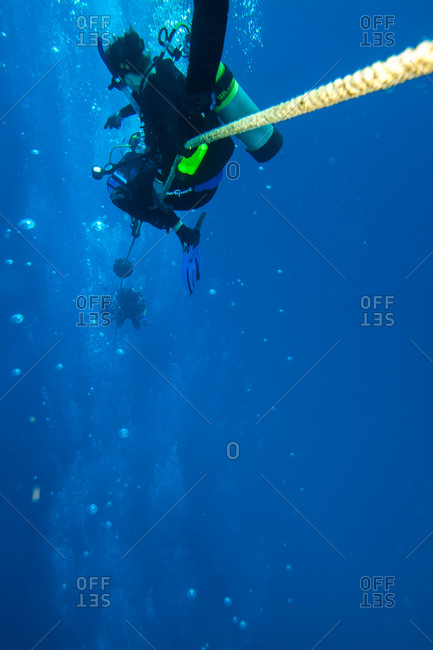 Technical divers ascending on rope