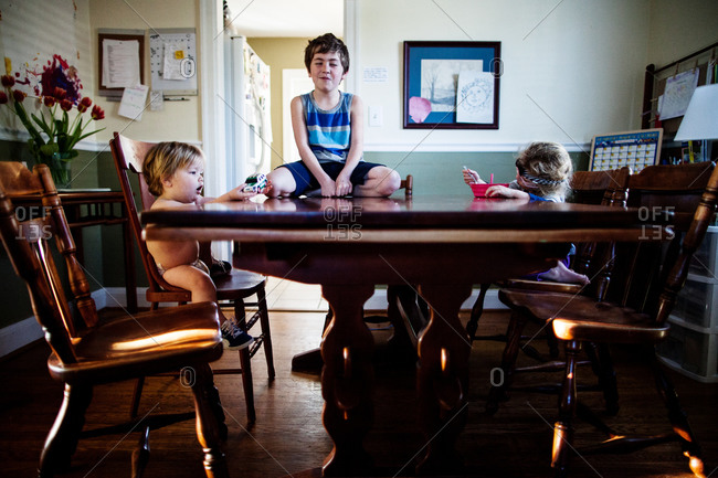 Kids sit at the breakfast table