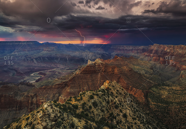 Lightning erupts from a summer thunderstorm over the Grand Canyon and the Colorado River