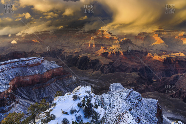 A winter storm sweeps across the Grand Canyon In the distance are Buddha Temple and Isis Temple, and Plateau Point above the Colorado River