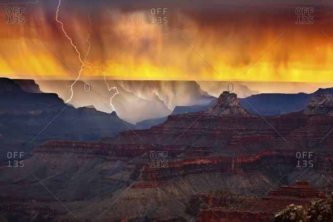 Lightning strikes the South Rim of Grand Canyon National Park near Hopi Point Captured from Cape Royal on the North Rim of the park nearly 12 miles away Zoroaster Temple is the prominent feature in the foreground