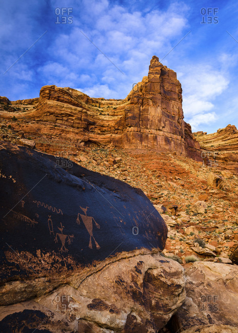 Looking up the 1,000 foot high cliffs of Cedar Mesa from a remote Anasazi petroglyph site in southern Utah