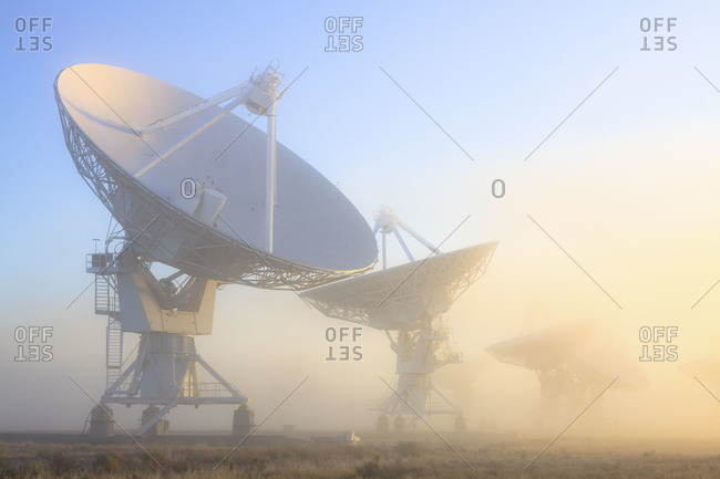 The National Radio Astronomy Observatory's 'Very Large Array' (VLA) in fog The Plains of San Agustin southwestern New Mexico