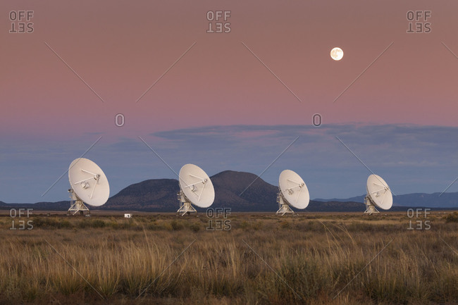 Moonrise over the National Radio Astronomy Observatory's 'Very Large Array' (VLA) in fog The Plains of San Agustin in southwestern New Mexico