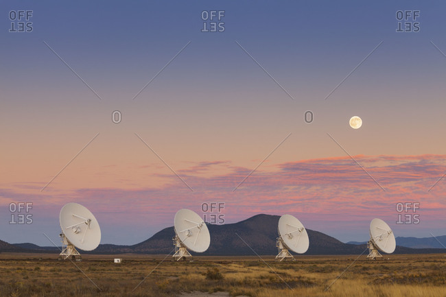 Moonrise over the National Radio Astronomy Observatory's 'Very Large Array' (VLA) in fog The Plains of San Agustin southwestern New Mexico