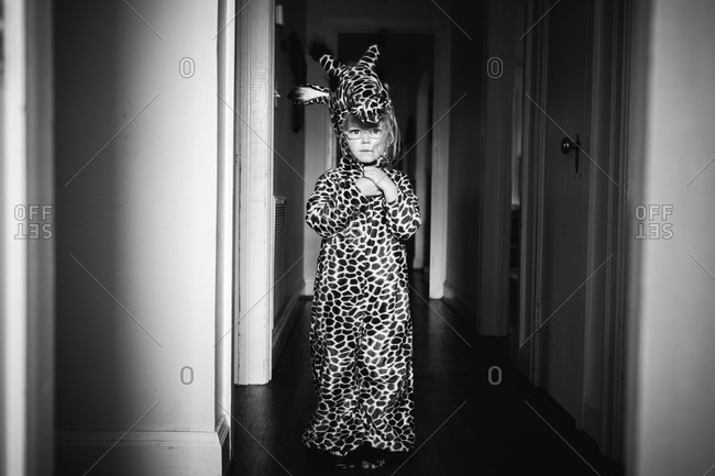 Portrait of a little girl wearing giraffe costume