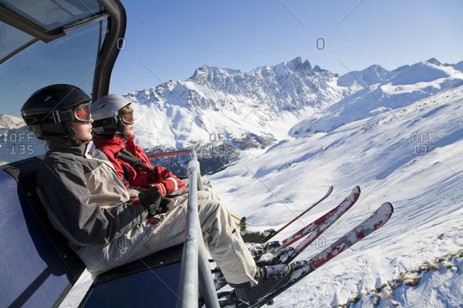 Switzerland, Graubuenden, Savognin, Children's (8-9) in ski lift
