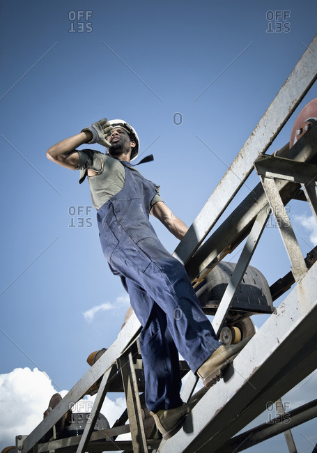 Germany, Augsburg, Worker calling from steel construction