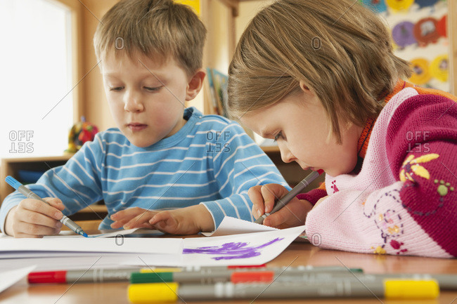 Germany, Children in nursery drawing pictures, portrait