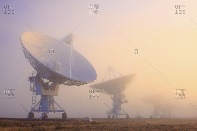 The National Radio Astronomy Observatory's Very Large Array in fog on the Plains of San Augustin in southwestern New Mexico