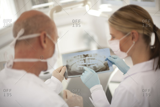 Germany, Bavaria, Landsberg, Dentist and Female Dentist Assistant holding an X-ray