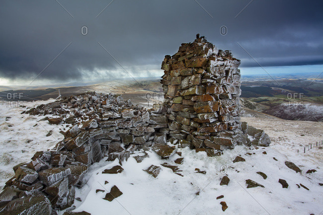 Auchope Cairn at the Summit of Auchope Rig, Cheviot, Scottish Boarder in the Distance, Northumberland, North East England, England