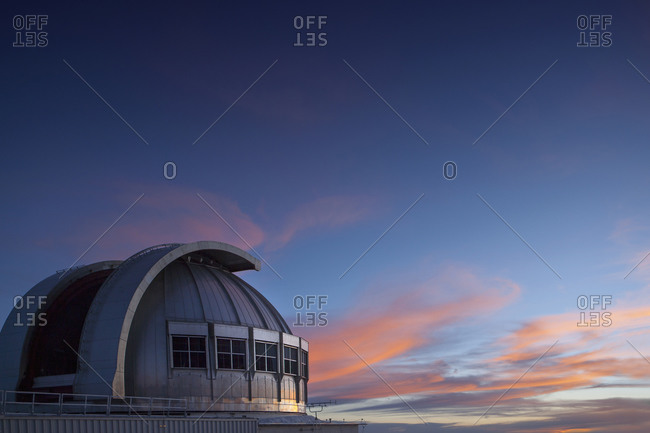 Observatory under colorful sunset sky, Mauna Kea, Hawaii, United States,