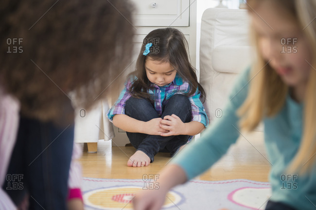 Girls playing without friend in living room