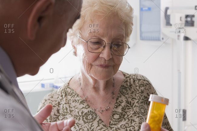 Hispanic doctor talking with older patient