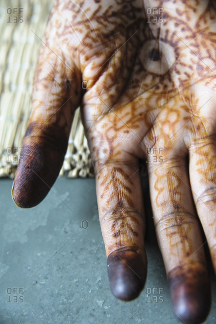 Close up of henna  tattooed hand