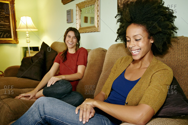 Women relaxing on sofa