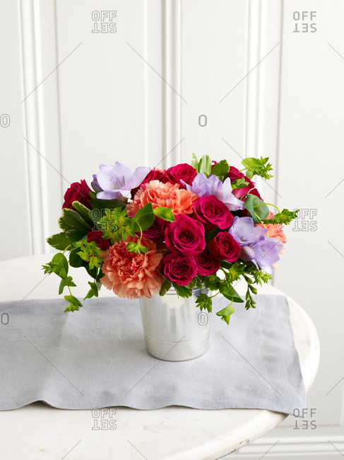Colorful spring flowers in bucket