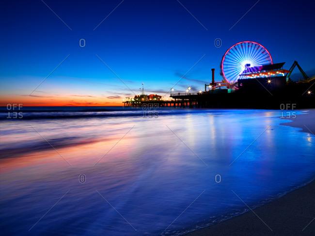 Sunset above ferris wheel in Santa Monica, California