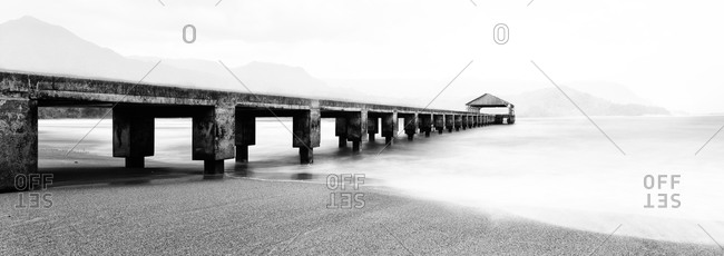 Black and white view of Hanalei Pier on the island of Kauai, Hawaii