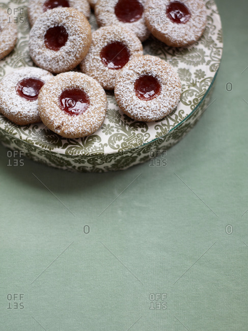 a pile of linzer thumbprint cookies