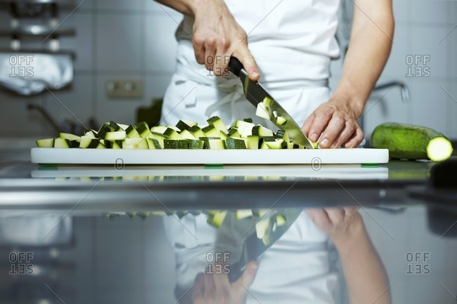 Chef chopping courgettes