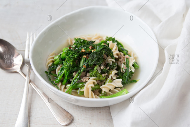 Broccoli rabe soup with pasta in bowl