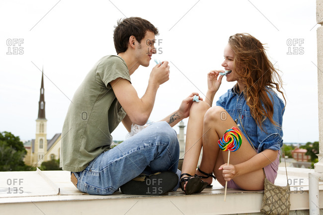 Young couple eating sweets