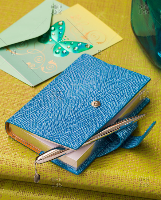 Close up of leather bound diary and greeting card
