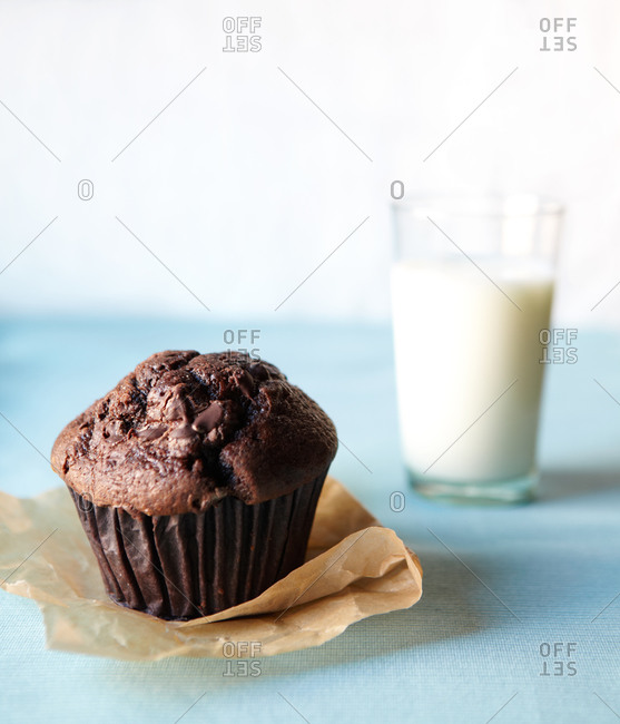 a chocolate muffin and a glass of milk