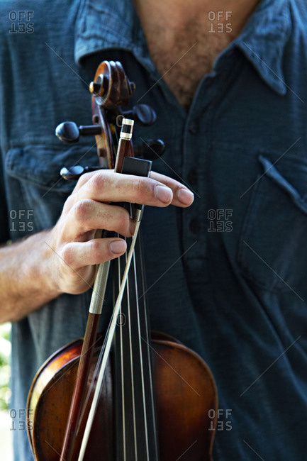 man holding a fiddle