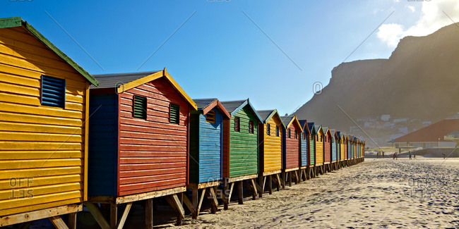 row of colorful huts on the beach