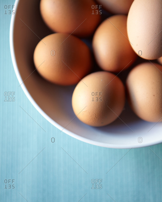 a bowl filled with brown eggs
