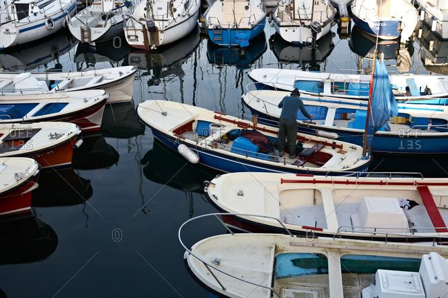a man docks his boat