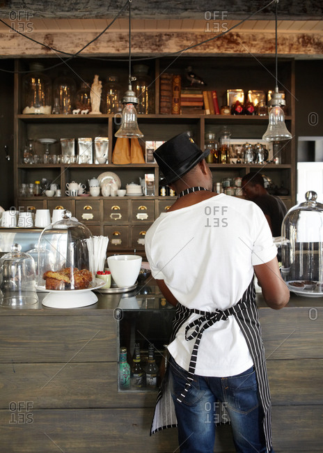 rear view of a man working at a coffee shop