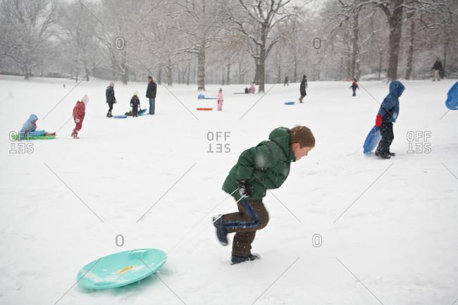 kids sledding in the winter