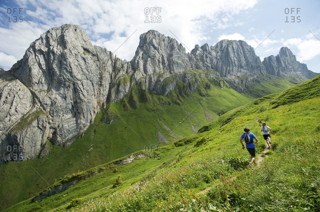 people hiking in the mountains of Appenzellerland, Switzerland