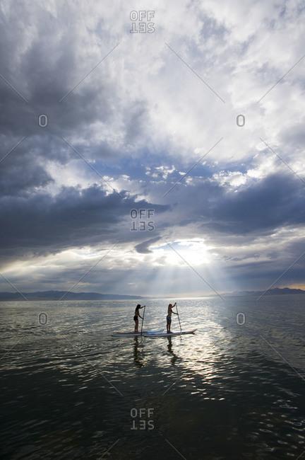 Two women paddle boarding on Great Salt Lake, Utah