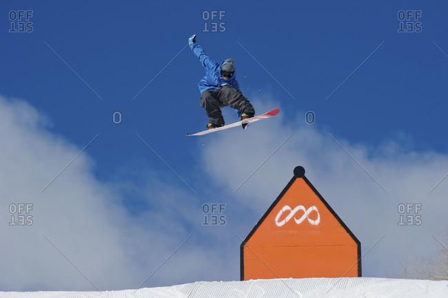 snow boarder mid jump